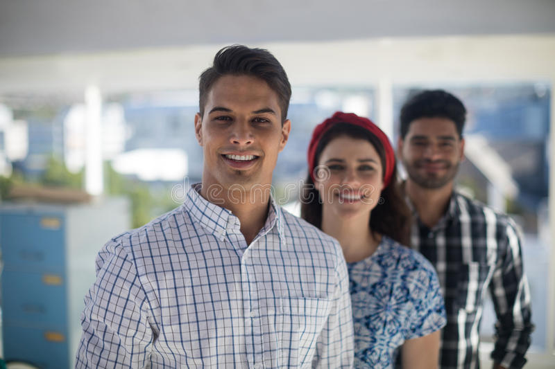 Team of executives standing together in the office stock photo