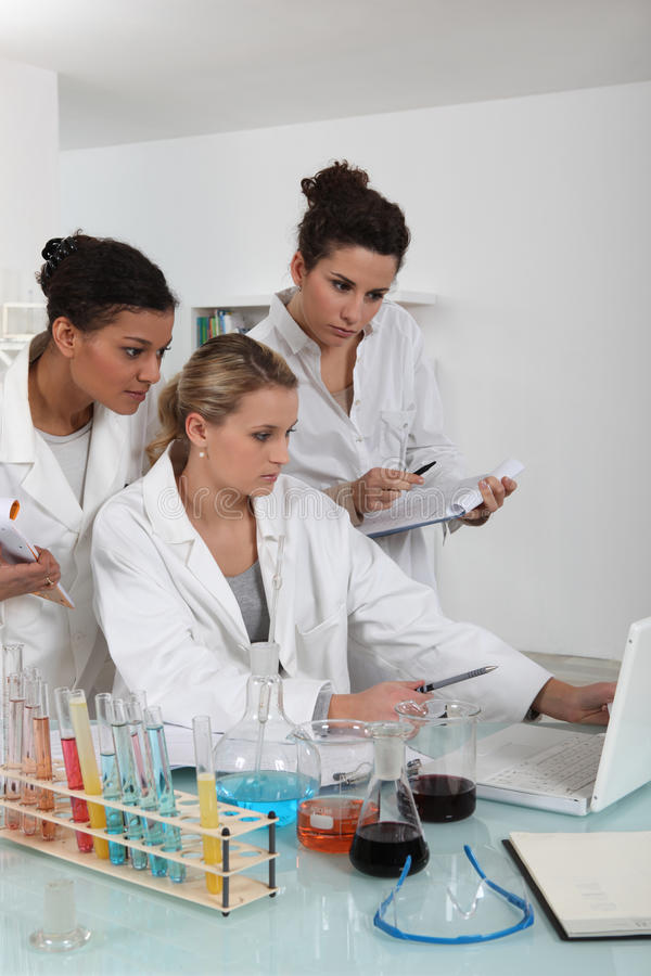 A team of female scientists royalty free stock image