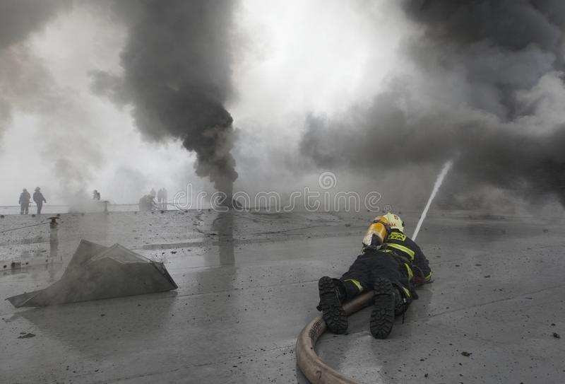 The Team Of Firemen Fighting With The Fire Editorial Stock Image