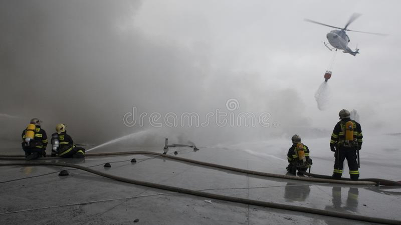 Download The Team Of Firemen Fighting With The Fire Editorial Image - Image: 15188920