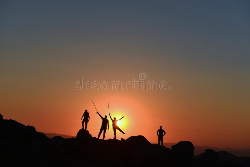 The joy of success of the climbers at sunrise time stock images