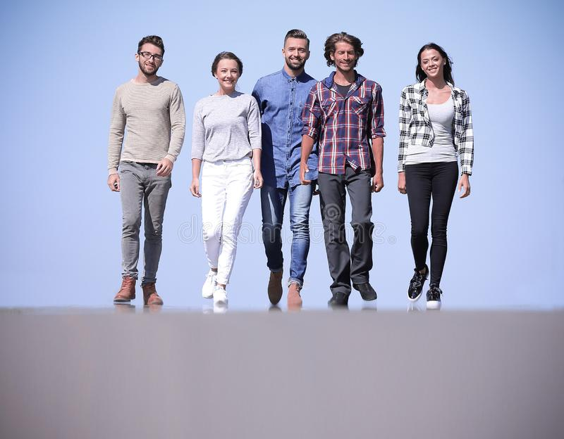 Team of friends, walks on the road. Outdoors.photo with copy space royalty free stock photography