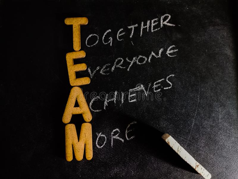 team full form together everyone achieves more displayed on chalkboard concept stock photo
