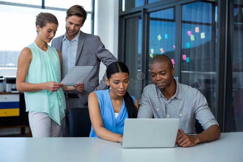 Team of graphic designers working together royalty free stock photos