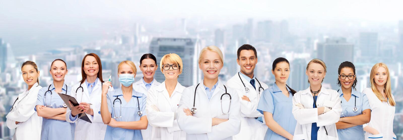 Team of groep artsen en verpleegsters stock afbeeldingen