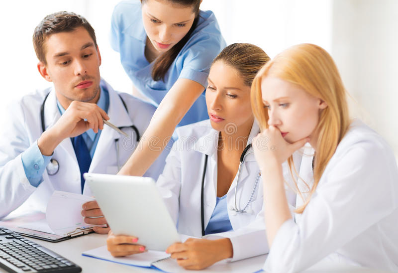 Team or group of doctors working stock photo