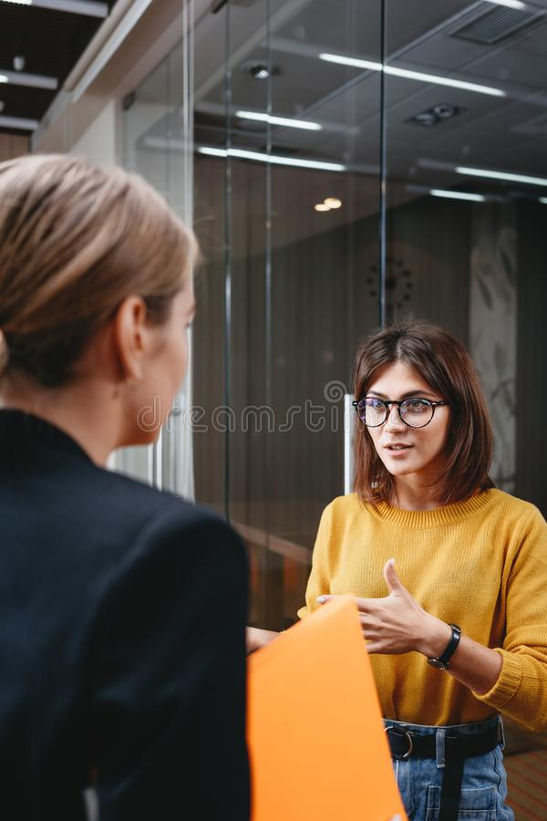 Team of handsome business women have meeting at modern office royalty free stock photography
