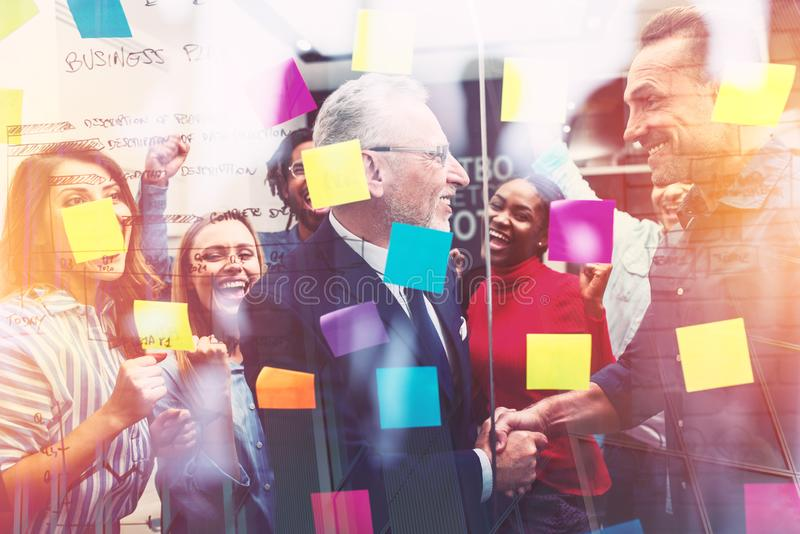 Team of happy people work together. concept of teamwork, partnership and success. Team of happy people work together in office. concept of teamwork, partnership royalty free stock images