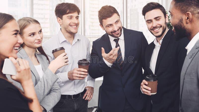 Team having small talk at their coffee break stock photo