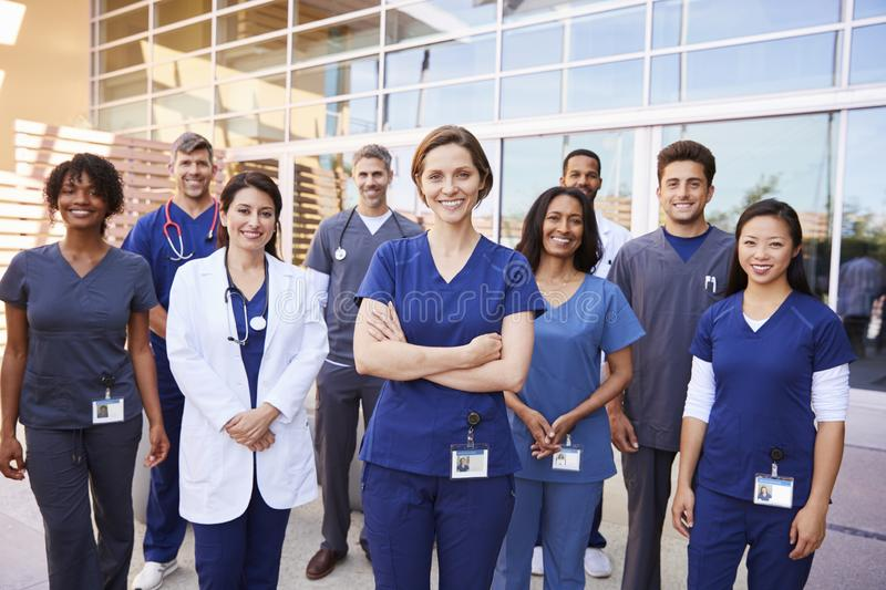 Team of healthcare workers with ID badges outside hospital stock photo