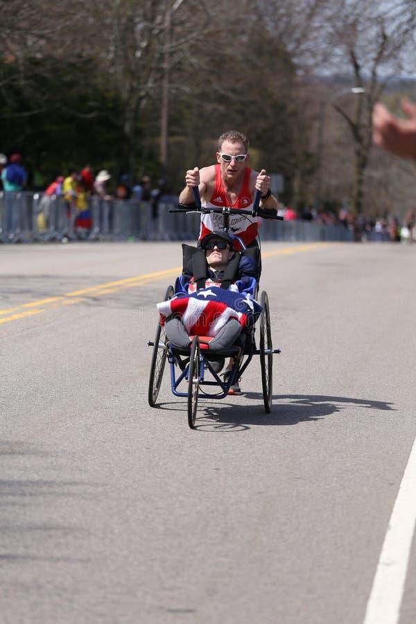 Team Hoyt runs in their 33rd marathon up Heartbreak Hill during the Boston Marathon. BOSTON - APRIL 18: Team Hoyt runs in their 33rd marathon up Heartbreak Hill stock photo