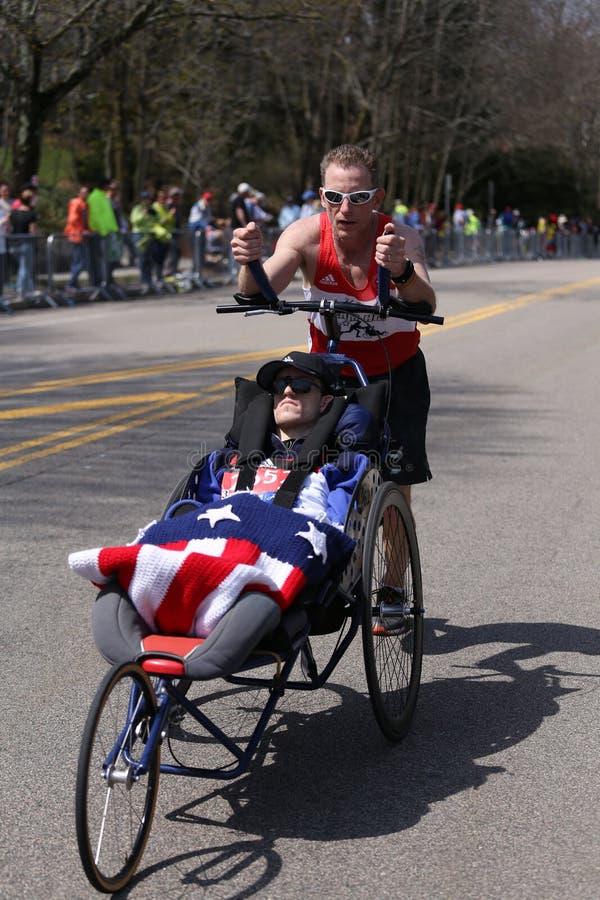 Team Hoyt runs in their 33rd marathon up Heartbreak Hill during the Boston Marathon. BOSTON - APRIL 18: Team Hoyt runs in their 33rd marathon up Heartbreak Hill royalty free stock photography