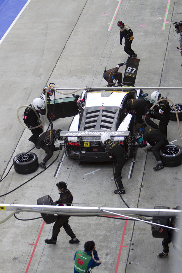 Team JLOC pits for tyres royalty free stock image