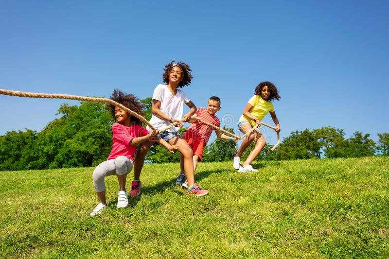 Team kids game of pulling rope in summer camp royalty free stock photos