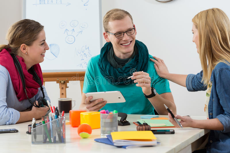 Team laughing at work stock photography