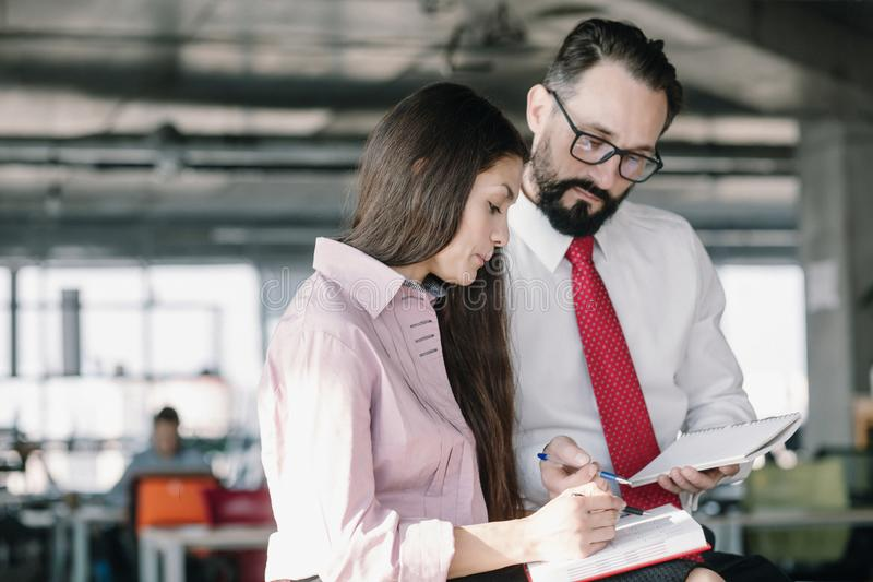Young team of coworkers making great meeting discussion. Team lead and female manager discussing agreement condition. Business concept royalty free stock photos