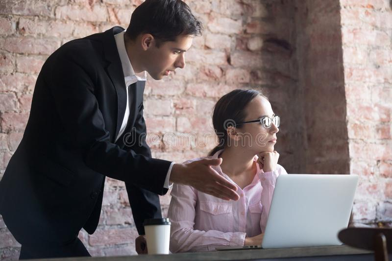 Team leader correcting offended employee at work. royalty free stock image