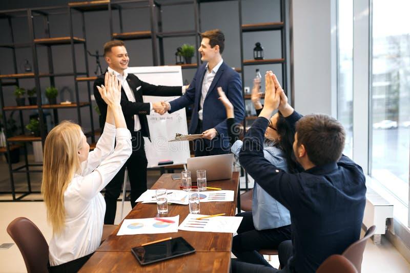 Team leader congratulating his creative partner royalty free stock image