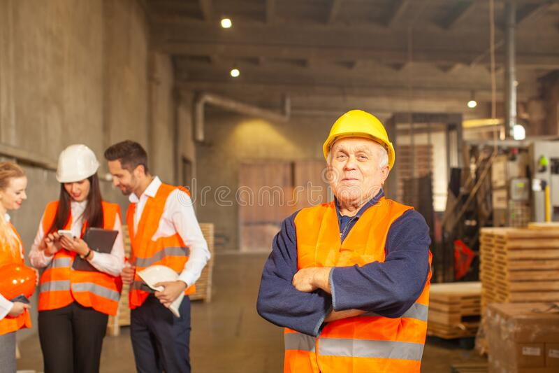 Team leader with his production group standing behind stock image