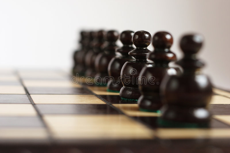 Team in line. On the chessboard stock image