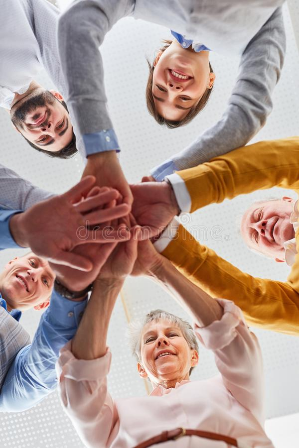 Team makes exercise in team building seminar stock image