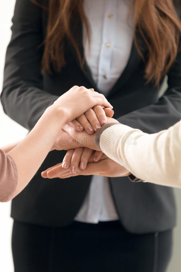 Team management concept, business people joining hands, vertical royalty free stock photos