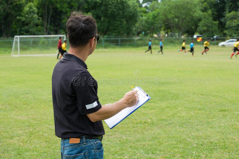 Team Manager Coaching his Crew beside Football or Soccer Field royalty free stock photos