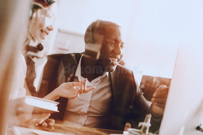 Team of Managers Working in Modern Call Center. Manager with Computer. Businessman on Workplace. Consultant with Microphone. royalty free stock images