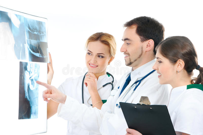A team of medical workers examining the x-ray royalty free stock photography