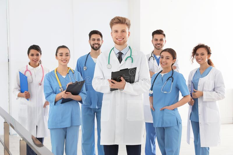 Team of medical workers in hospital stock photos