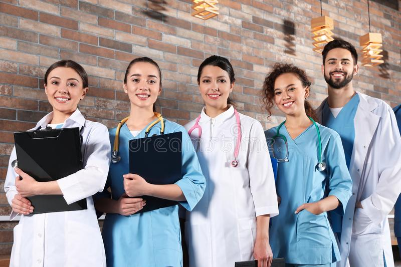 Team of medical workers in hospital stock images