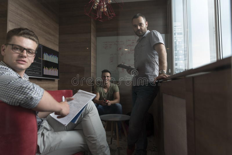 Team meeting and brainstorming in small private office royalty free stock photos