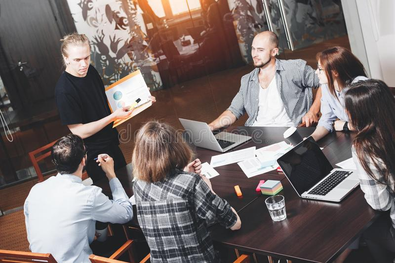 Team meeting and discuss new startup. Analysis of graphs and diagrams of new project. Teamwork coworking people in modern space. stock image