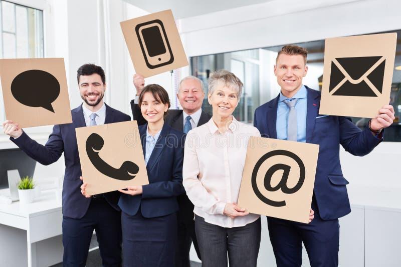 Team mit Kontaktwahlen stockfoto