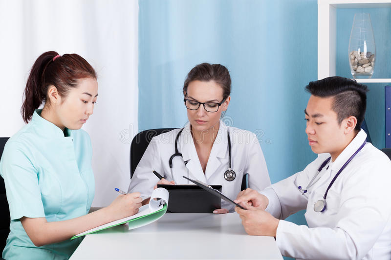 Team of mixed-race doctors royalty free stock photos