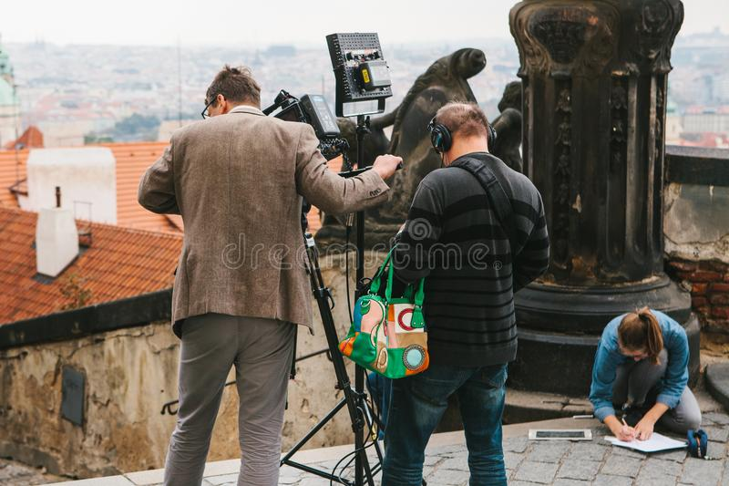Prague, October 28, 2017: Team of operators shoot report next to the Prague Castle stock photography