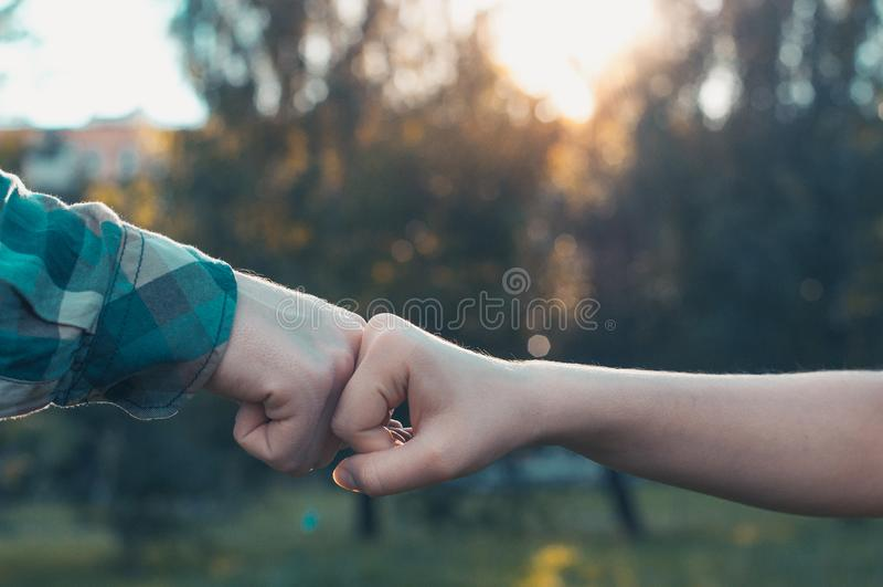 Team partners giving fist bump stock photos