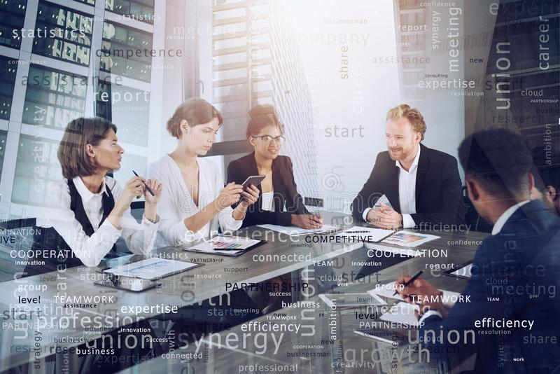 Team of people work together. concept of teamwork and partnership. Most important business terms in overlay stock photo