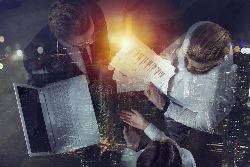 Team of people work together in office. Concept of teamwork and partnership. Double exposure. stock photography