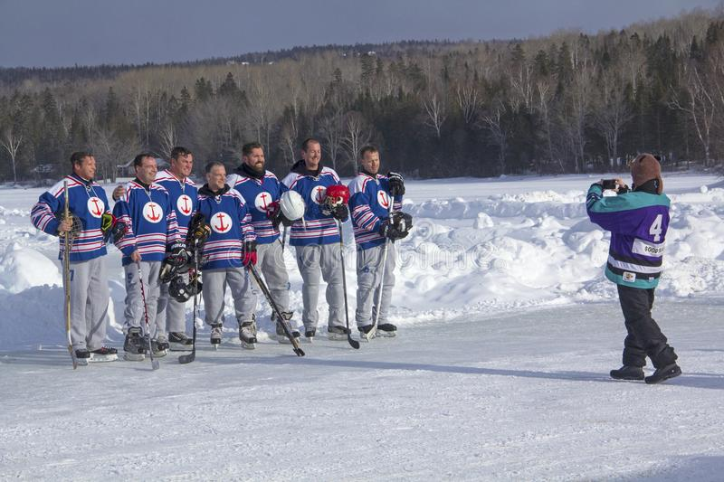 Team photo at the New England Pond Hockey Festival, Rangeley, Ma royalty free stock images