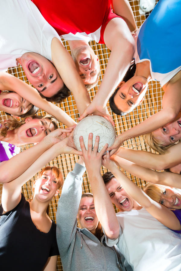 Team playing football or soccer sport indoor stock image