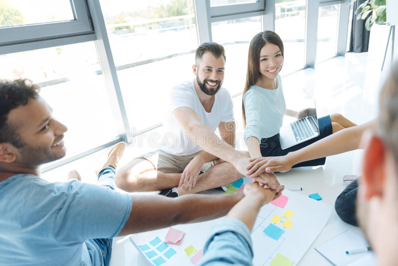 Team of positive young people being ready to work royalty free stock images