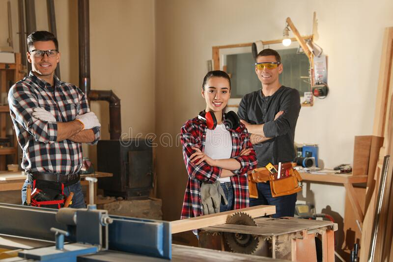 Team of professional carpenters in workshop stock images