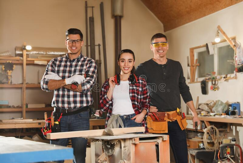 Team of professional carpenters in workshop royalty free stock photo