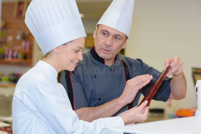 Team professional chef in modern restaurant royalty free stock image