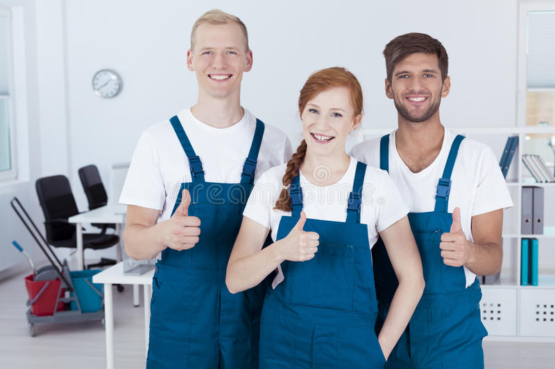 Team of professional cleaners royalty free stock photography
