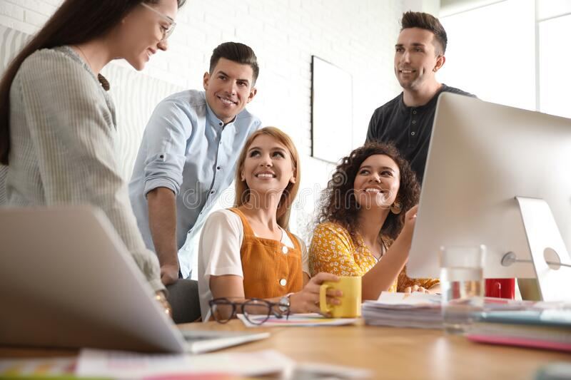 Team of professional designers working. In office royalty free stock image