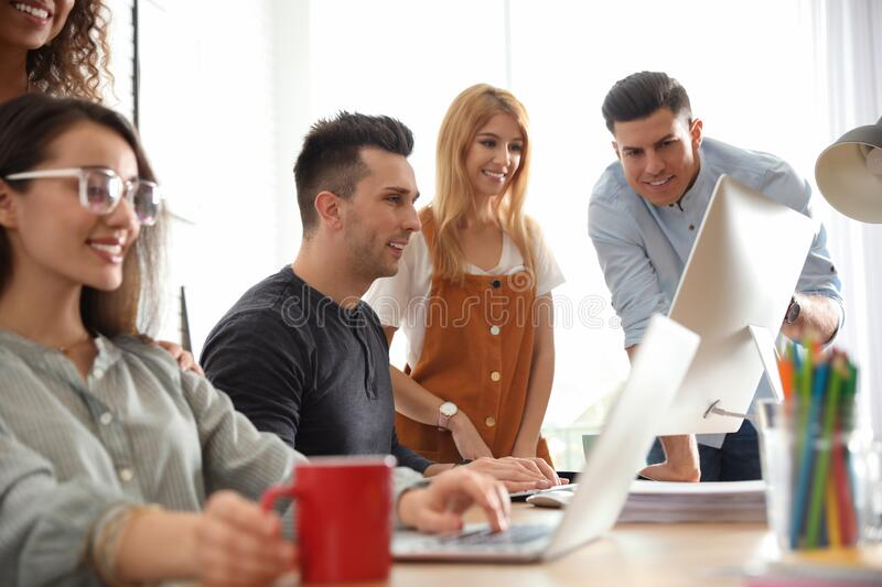 Team of professional designers working. In office stock images