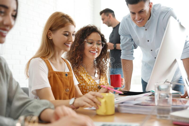 Team of professional designers working royalty free stock photo