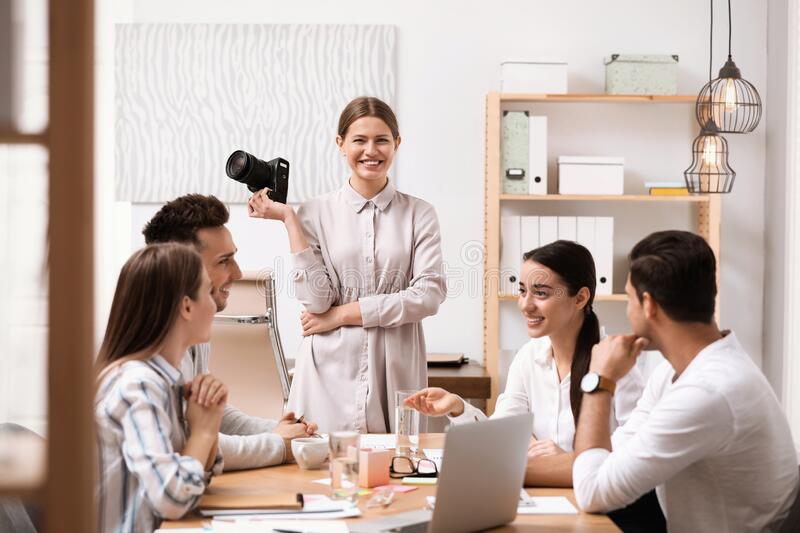 Team of professional journalists working stock photography